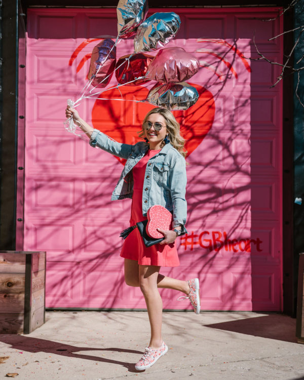 Bows & Sequins jumping in front of the #GBHeart pink door in Chicago.