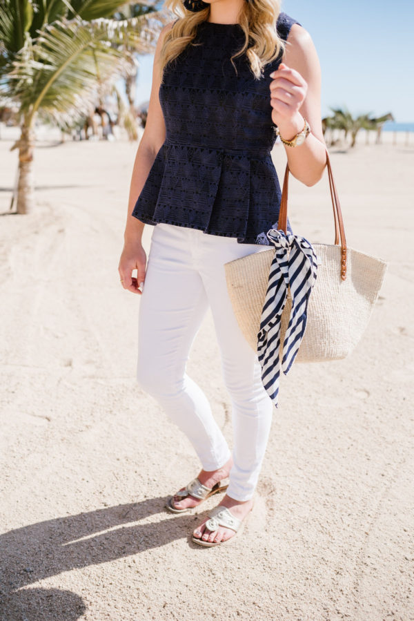 Travel blogger Bows & Sequins wearing a blue peplum top and Old Navy white jeans in Mexico.