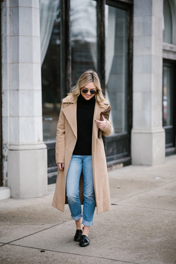 Bows & Sequins styling a long camel coat for a spring outfit when it's still cold outside.
