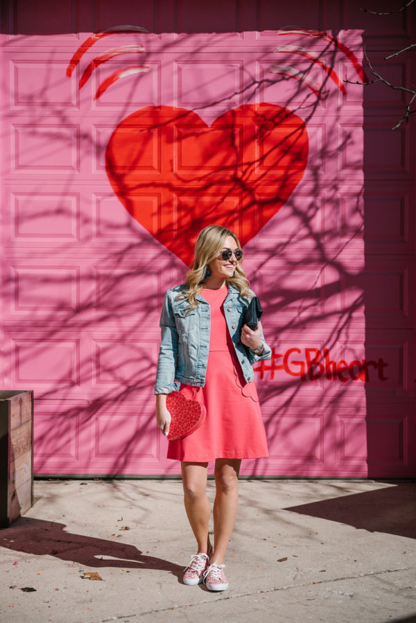 Bows & Sequins wearing a pink dress, sneakers, and a jean jacket.