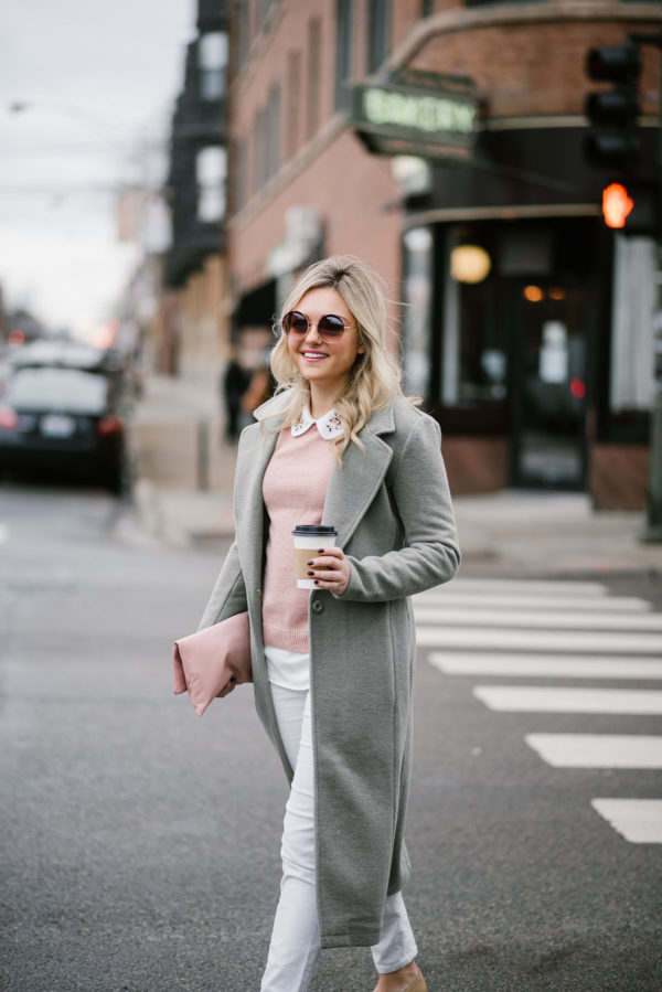 Fashion blogger Bows & Sequins wearing green jacket and white jeans in Chicago.