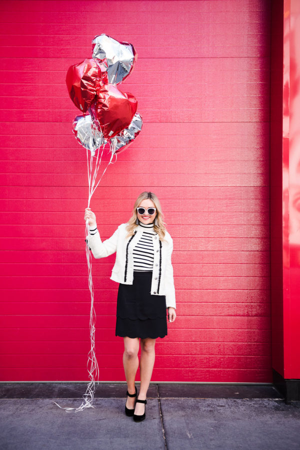 Bows & Sequins wearing a black and white outfit for Valentine's Day.