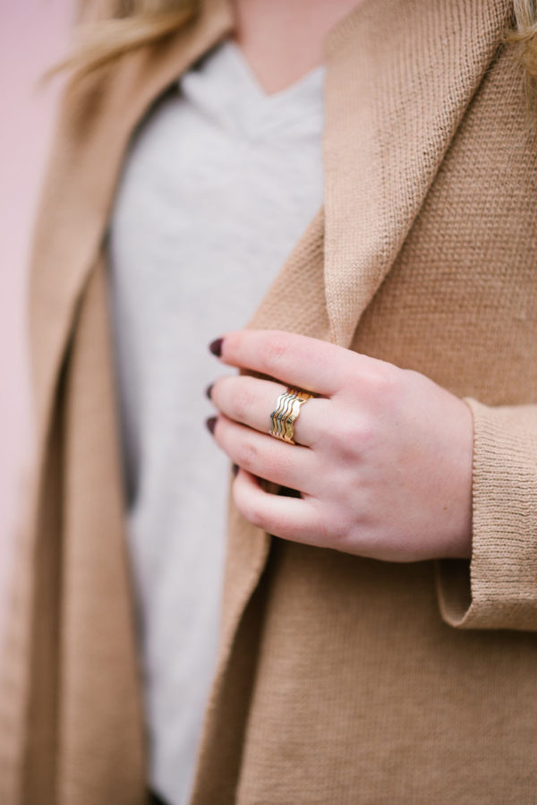 Bows & Sequins wearing delicate stacking rings from Sweet & Spark.