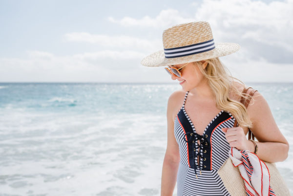 Bows & Sequins styling a navy striped swimsuit with a Clare V Kenya bag and an Echo silk printed scarf.