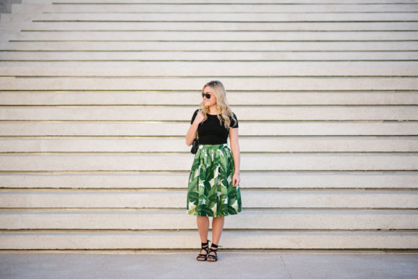 Bows & Sequins wearing a Party Skirts midi, black crop tee, and M.Gemi sandals in Cabo San Lucas.