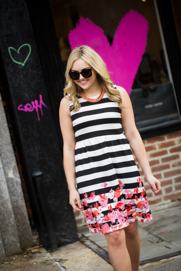 Bows & Sequins wearing a black and white striped dress for Valentines Day.