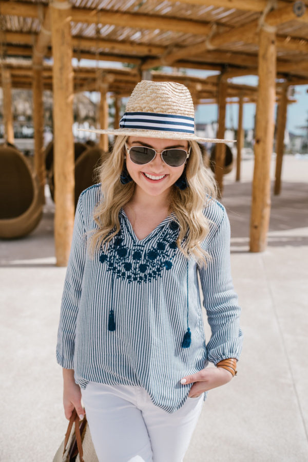 Bows & Sequins wearing an embroidered Old Navy top and striped Hat Attack x Lemon Stripes hat in San Lucas Mexico.