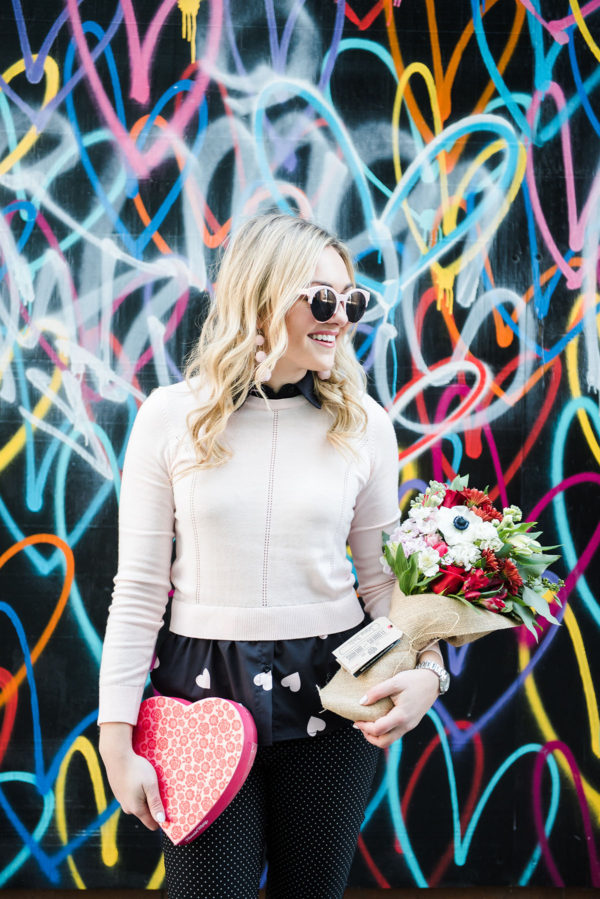 Bows & Sequins in front of the Bleeding Hearts mural in Wicker Park with a Flowers for Dreams bouquet in Chicago.