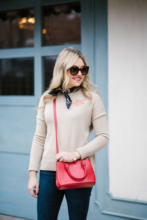 Fashion blogger Bows & Sequins styling a Maje sweater with a silk neck scarf. Tres chic!