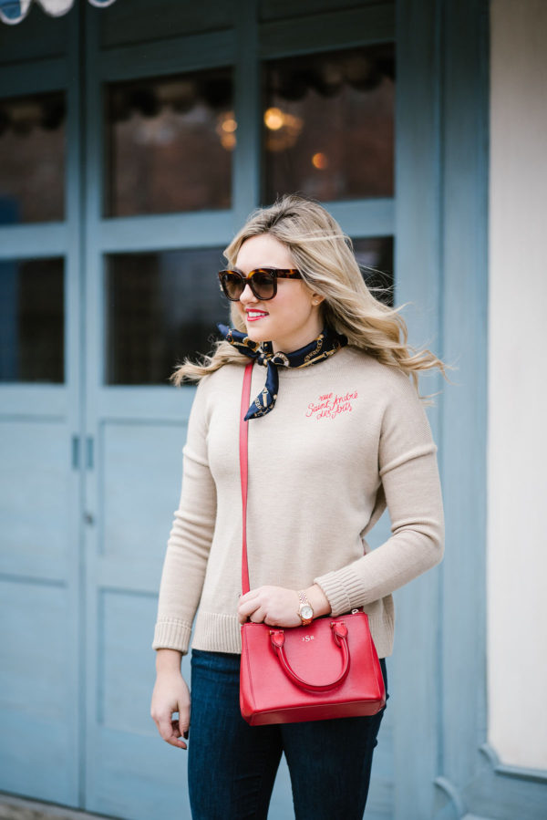 Blogger Bows & Sequins wearing a camel cashmere sweater with red embroidery Rue Saint-Andre des Arts