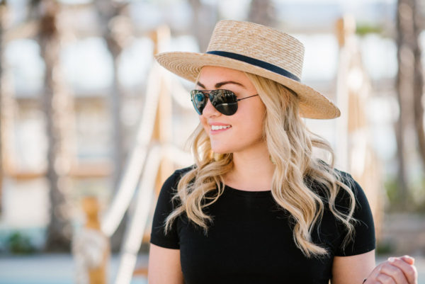 Bows & Sequins wearing a Janessa Leone boater hat and Ray-Ban black aviators in Cabo.