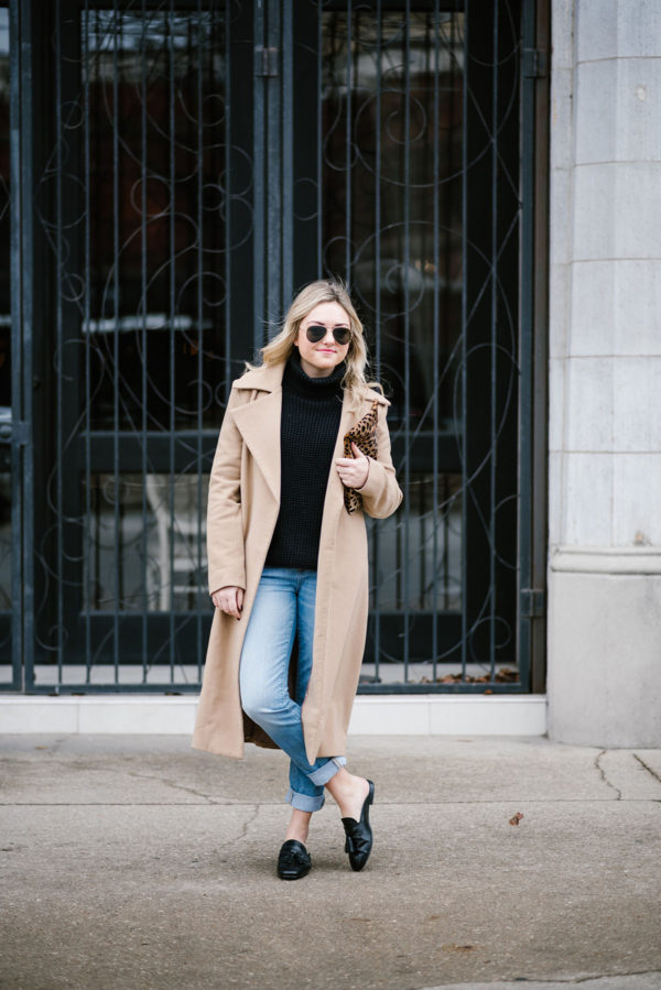 Bows & Sequins wearing a long camel coat with boyfriend jeans.
