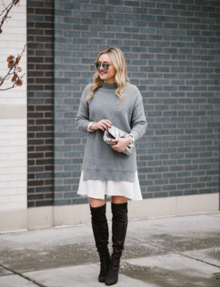 Bows & Sequins wearing a layered sweater dress with grey suede over the knee boots.