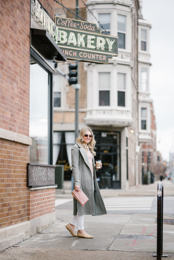 Bows & Sequins wearing mint green coat with a blush pink clutch.