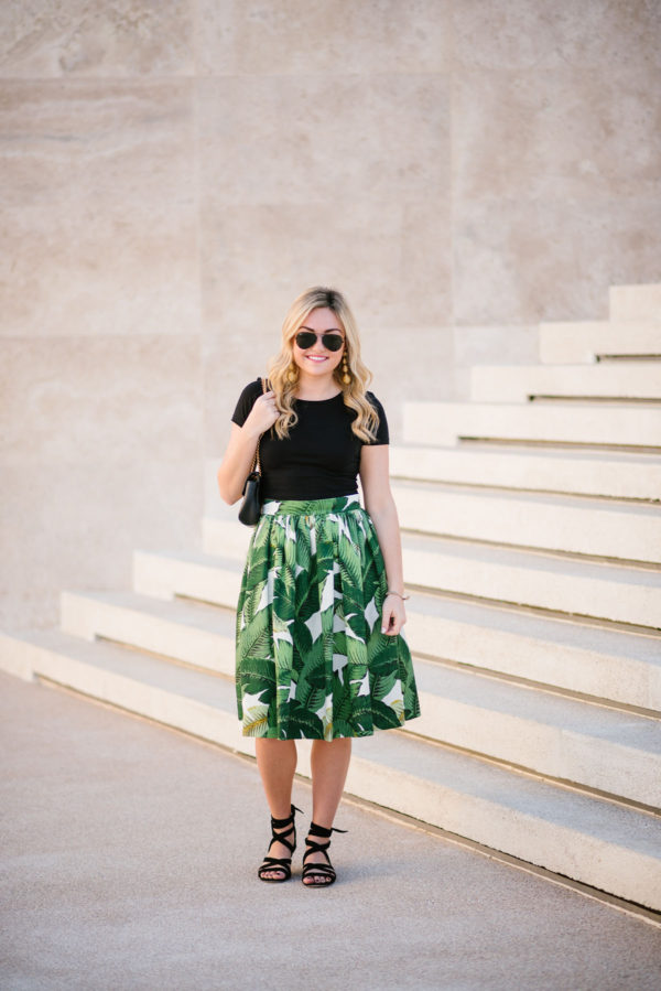 Lifestyle blogger wearing a black crop top tee with a Gucci Marmont bag and Ray-Ban black aviators at the Paradisus hotel.