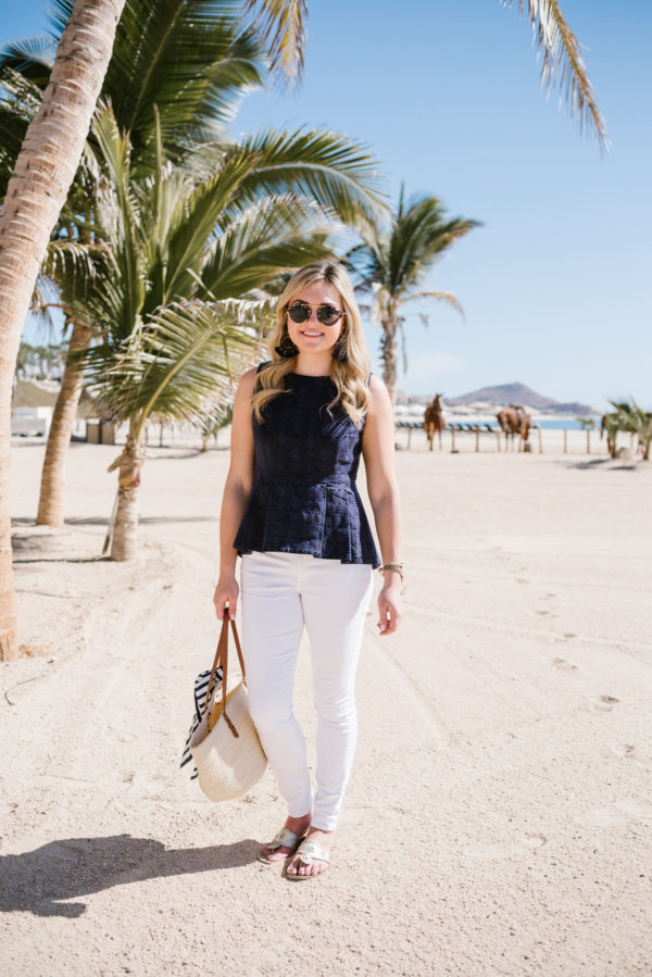 Bows & Sequins wearing a Sail to Sable blue peplum top on the beach in Cabo Mexico.