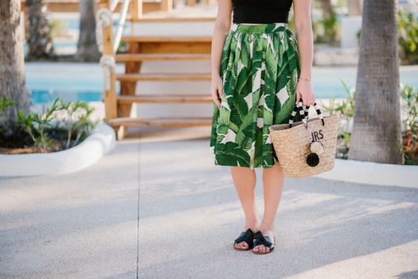 Bows & Sequins in a palm leaf skirt and Kate Spade bow sandals.