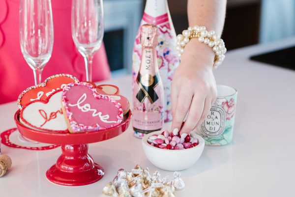 Bows & Sequins Valentine's Day party with cookies champagne and candy.