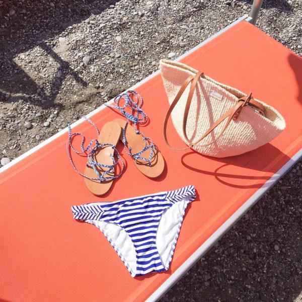 Orange Beach Chairs in Positano, Italy with a Striped Bikini and Straw Tote