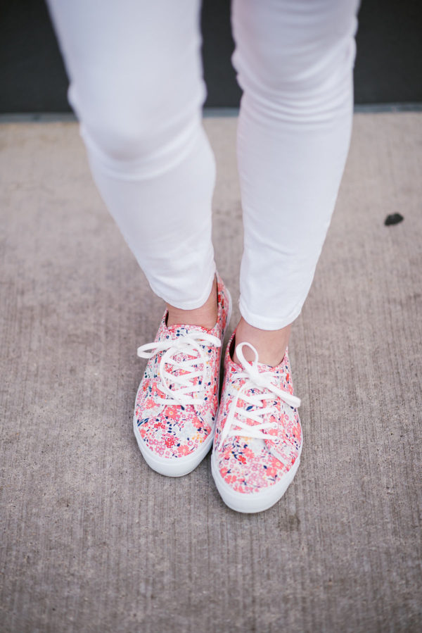Bows & Sequins styling fun, floral sneakers with a pair of white jeans.