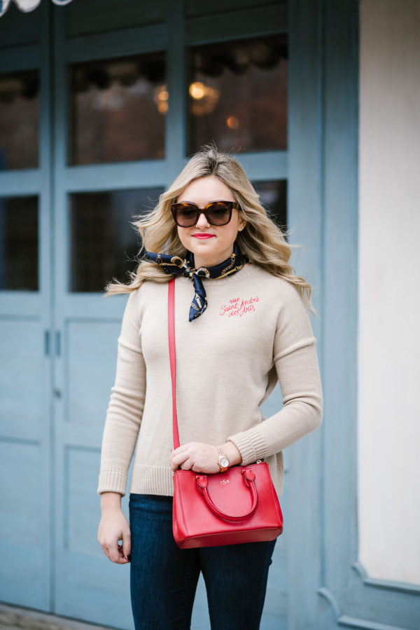 Fashion blogger Bows & Sequins wearing a casual outfit inspired by Paris! Maje Sweater, Celine sunglasses, silk scarf, and a crossbody bag.