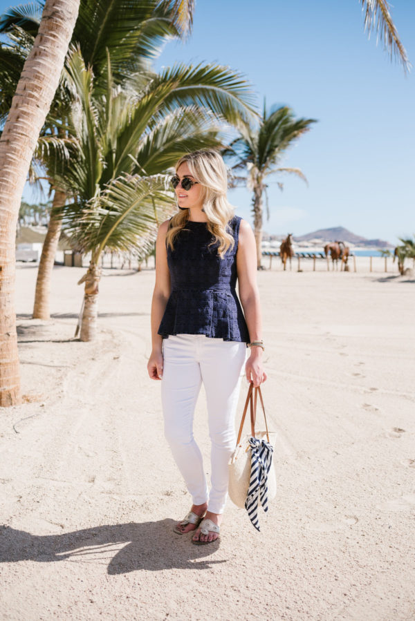 Bows & Sequins wearing a Sail to Sable blue peplum top and Old Navy white jeans with Jack Rogers sandals.