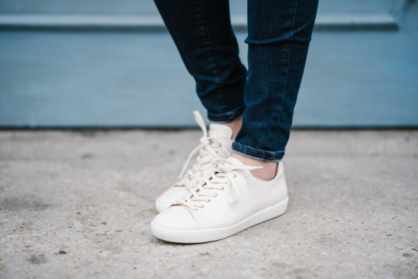 Bows & Sequins wearing Sezane Jack sneakers in cream-colored leather.