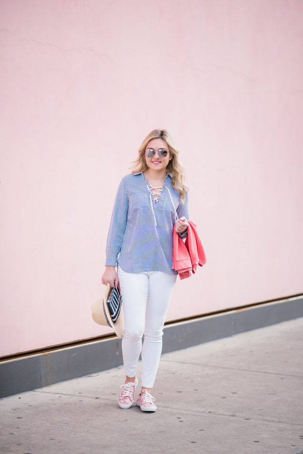 Bows & Sequins wearing a blue and white lace up striped top.