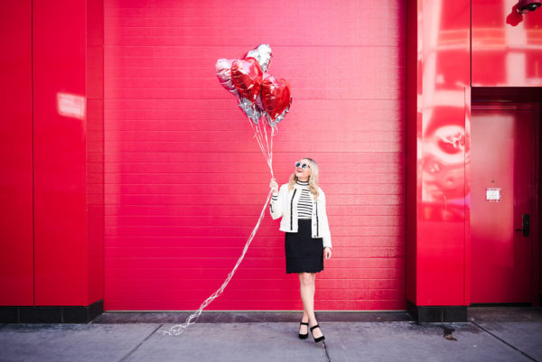 Bows & Sequins taking photos with balloons in front of Ikram in Chicago.