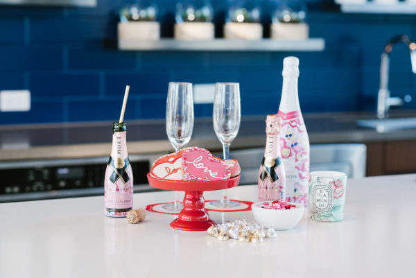 Bows & Sequins hosting a Valentine's Day party in Chicago with champagne cookies and candy.