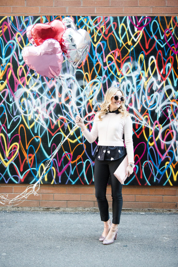 Bows & Sequins taking photos with balloons in front of the Bleeding Hearts mural in Chicago for Valentine's Day.