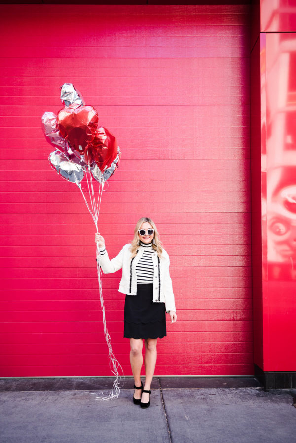 Bows & Sequins wearing a tweed jacket, striped turtleneck, scalloped skirt, and velvet mary janes.