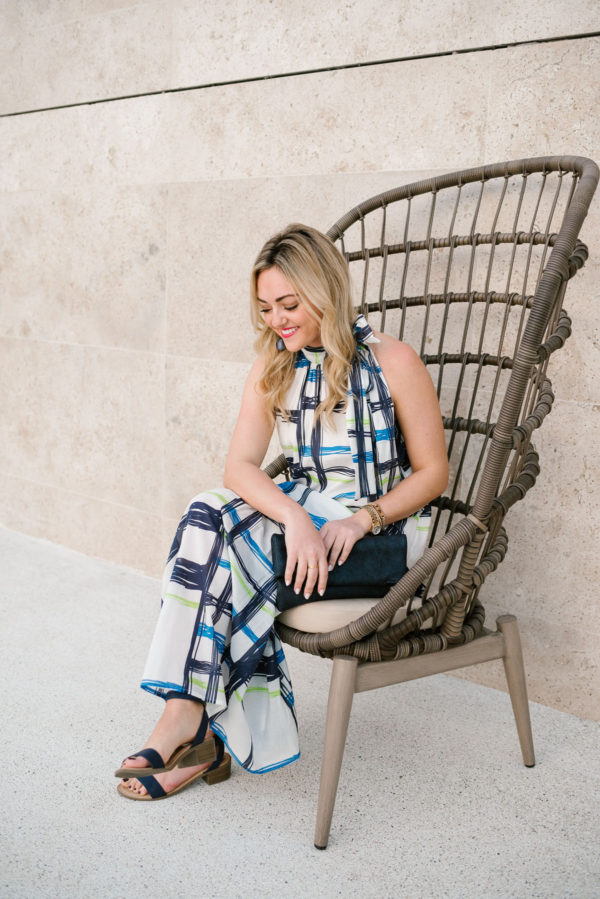 Bows & Sequins wearing a blue printed maxi dress with an Azalea blue leather tassel clutch in Cabo Mexico.