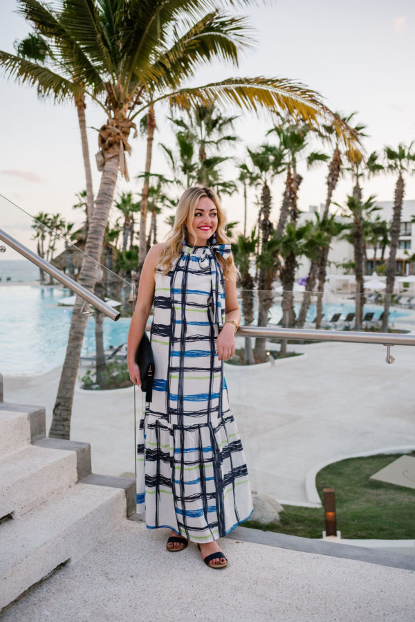 Blogger Bows & Sequins wearing a blue printed maxi dress in Cabo San Lucas.