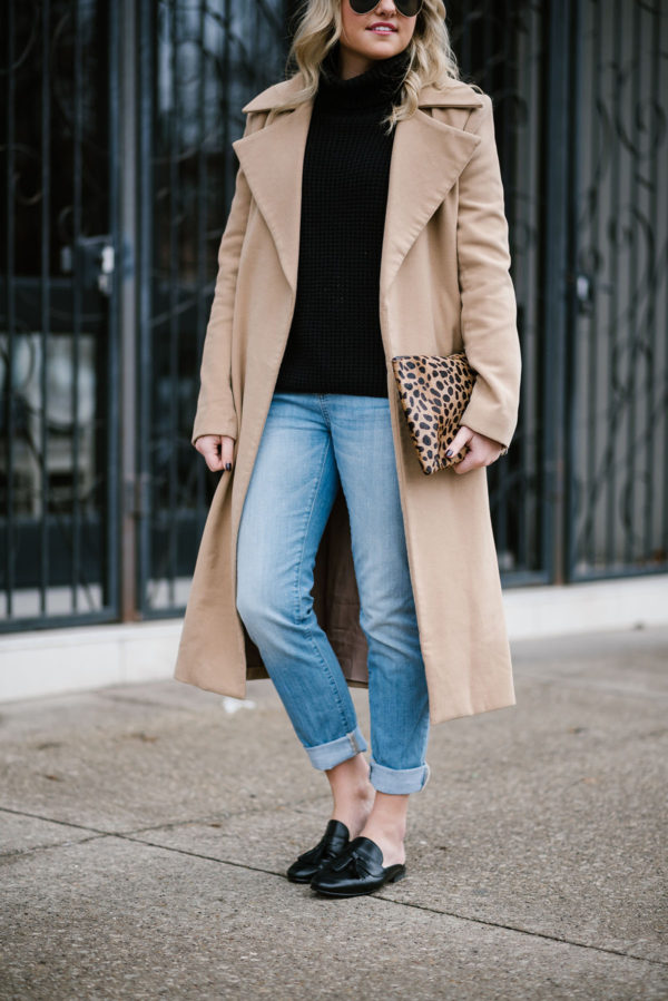 Bows & Sequins styling a long camel coat with boyfriend jeans and black leather slides.
