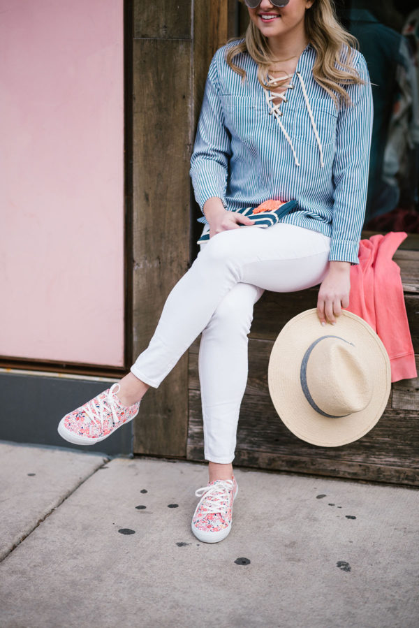 Bows & Sequins wearing white jeans, a striped top, and floral sneakers for a casual springtime outfit.