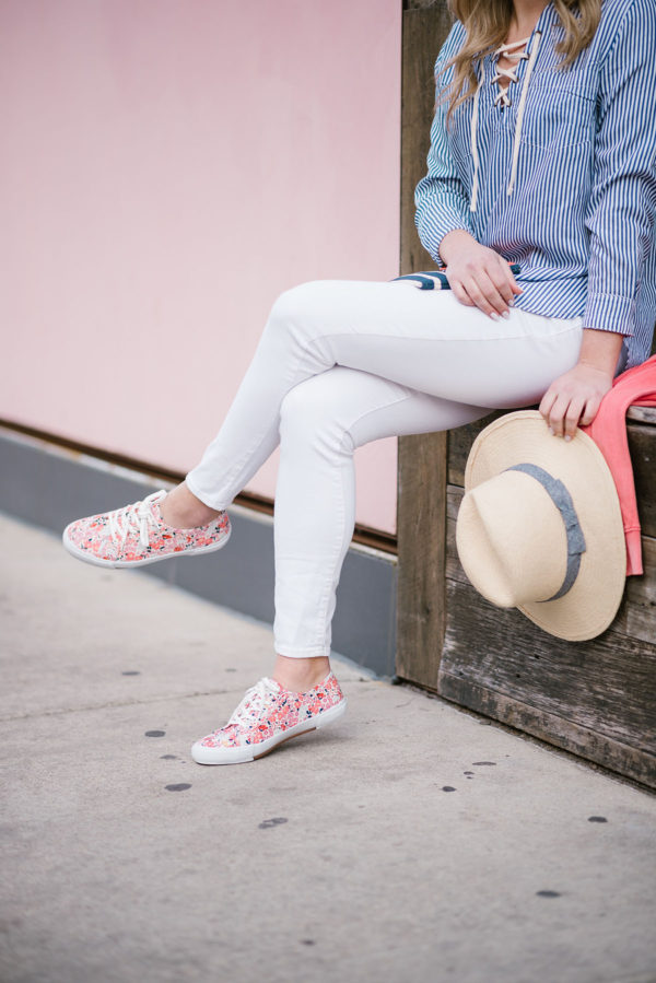 Bows & Sequins wearing white jeans with bright sneakers and a straw hat.