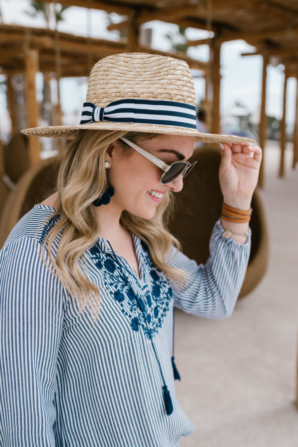 Fashion blogger Bows & Sequins wearing a blue & white striped Old Navy blouse and a Hat Attack x Lemon Stripes striped hat.