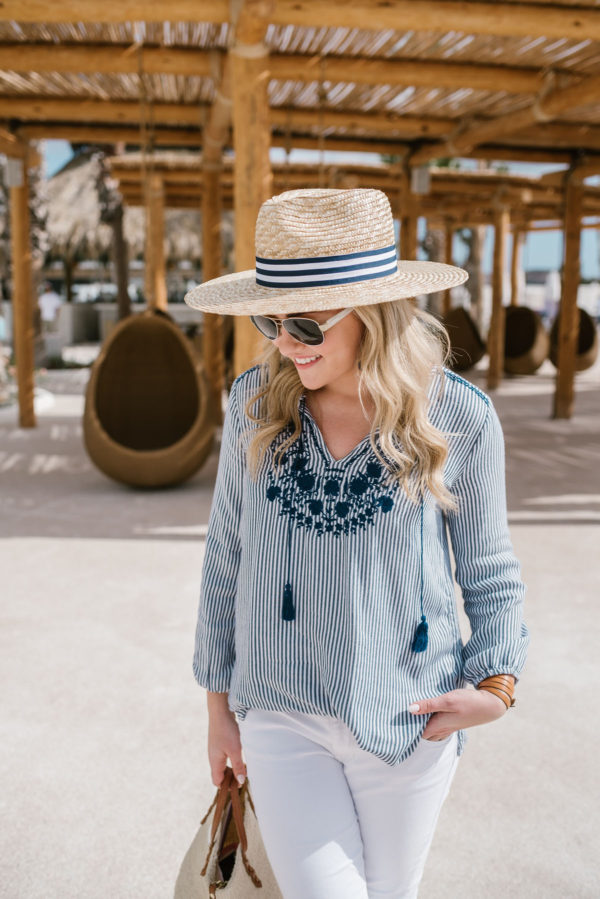 Bows & Sequins wearing a blue and white striped Old Navy outfit in Cabo.
