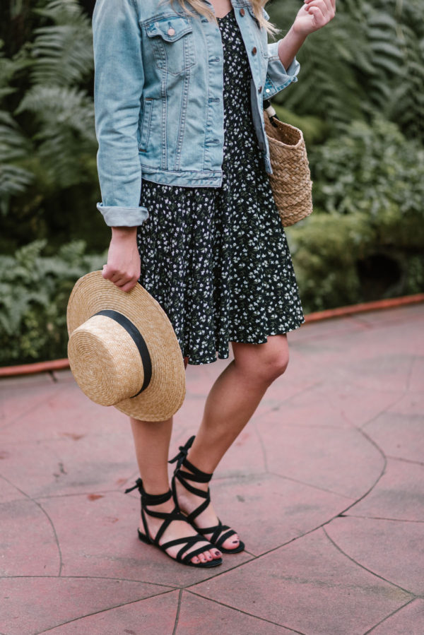 Bows & Sequins wearing black M.Gemi sandals with a Janessa Leone hat.