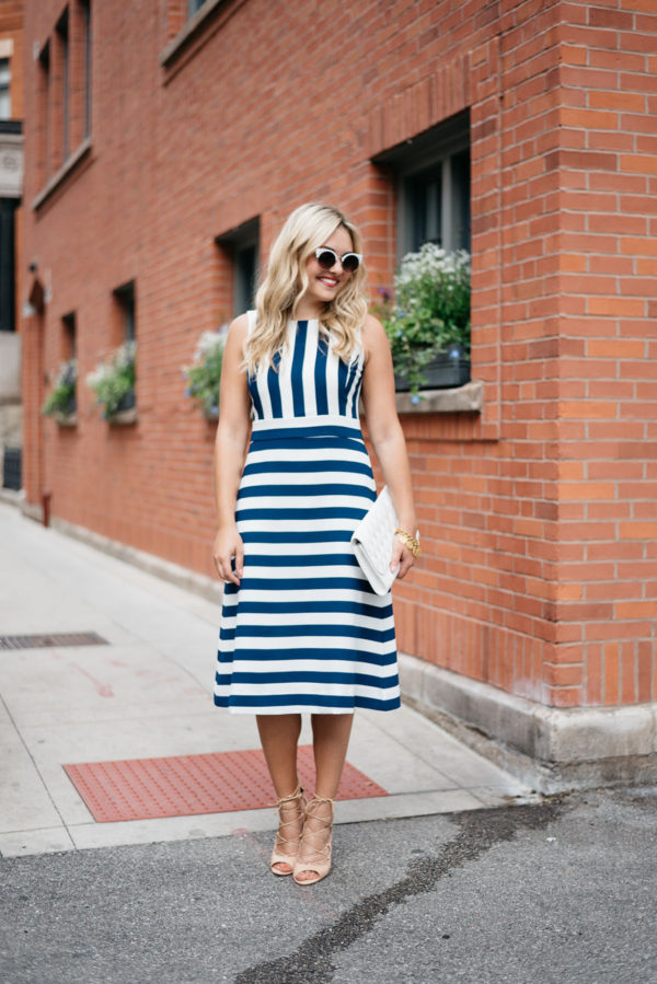 Bows & Sequins wearing a blue and white striped dress in Chicago.