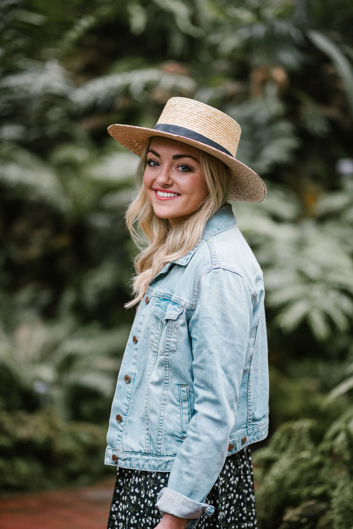Chicago style blogger Bows & Sequins wearing a Janessa Leone hat with a denim jacket.