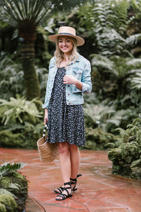 Chicago blogger Jessica Sturdy wearing an Old Navy floral dress with black lace up sandals and a denim jacket.