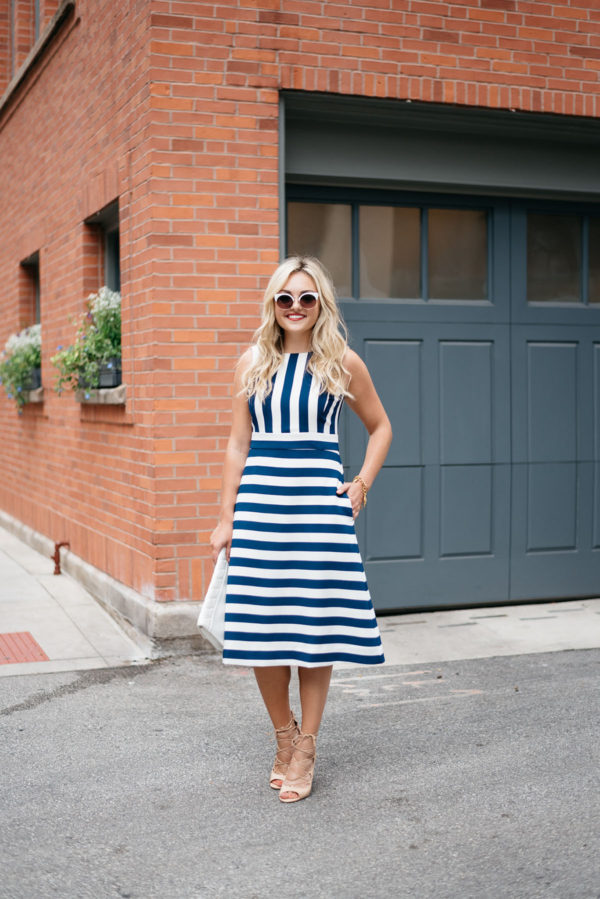 Bows & Sequins styling a blue and white striped fit and flare dress.