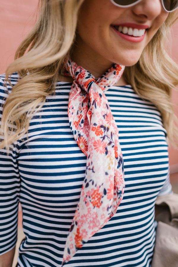 Fashion writer Bows & Sequins wearing a navy striped scoop tee with a floral printed neckerchief scarf.