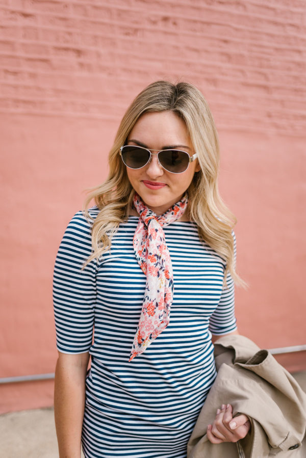 Bows & Sequins styling a floral scarf with a striped tee and white aviator sunglasses.