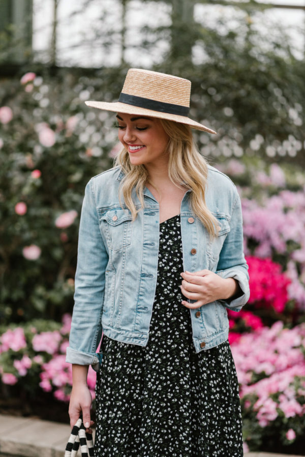 Bows & Sequins wearing a Janessa Leone hat with an Old Navy printed dress.