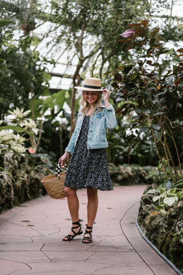Blogger Bows & Sequins wearing an Old Navy summer dress with a denim jacket and lace-up flat sandals for spring.