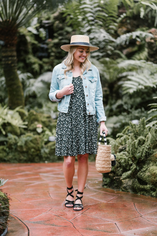 Bows & Sequins wearing a denim jacket and an Old Navy dress in an arboretum.