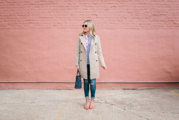 Jessica Sturdy wearing an Old Navy trench coat and coral ankle-strap heels with a navy Kate Spade handbag.